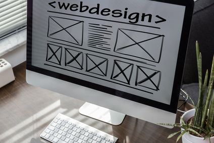 image of computer with webdesign on the monitor screen